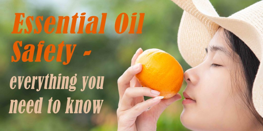 woman smelling an orange