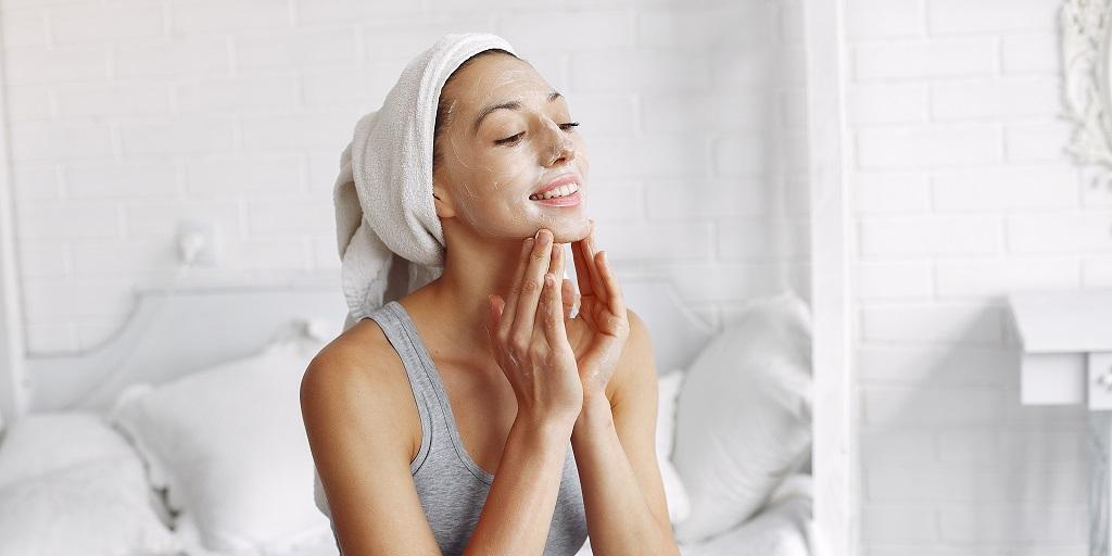 girl applying beauty regimen