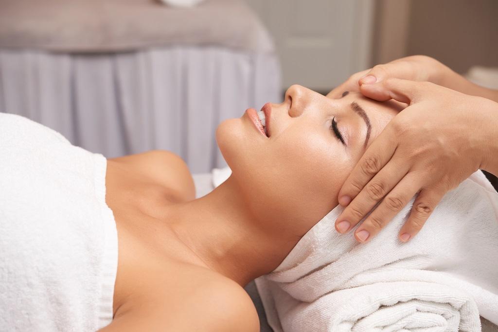 girl receiving facial massage treatment