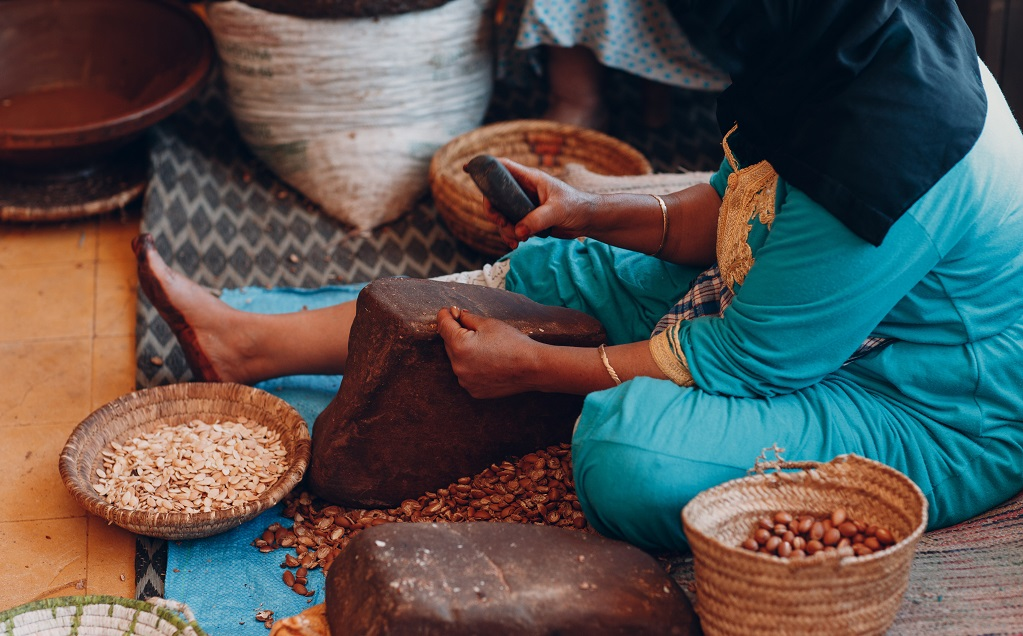 Woman making argan oil by hand craft