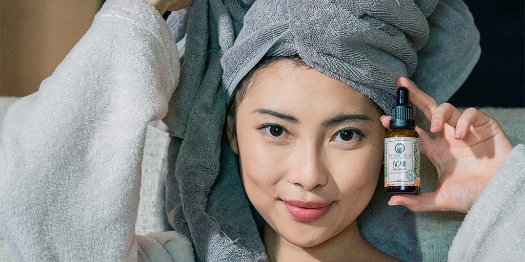 model with acne serum