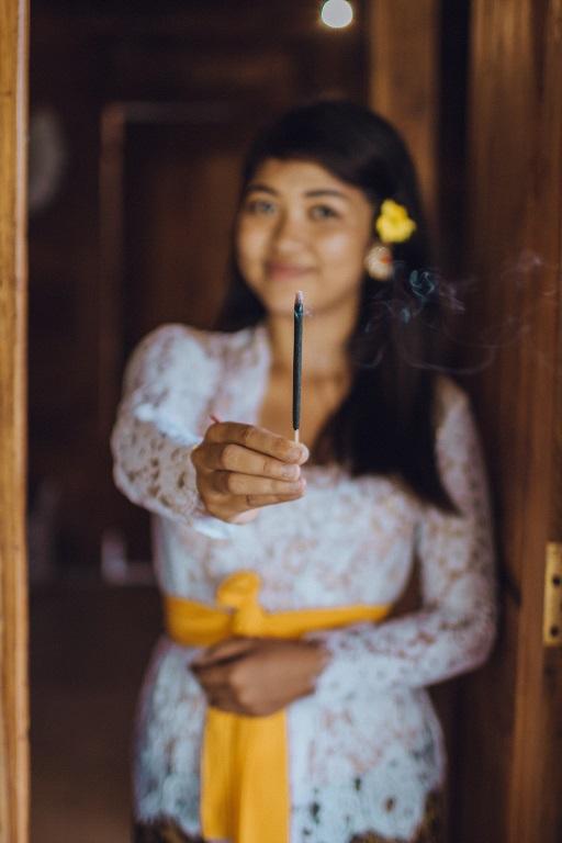 girl burning incense