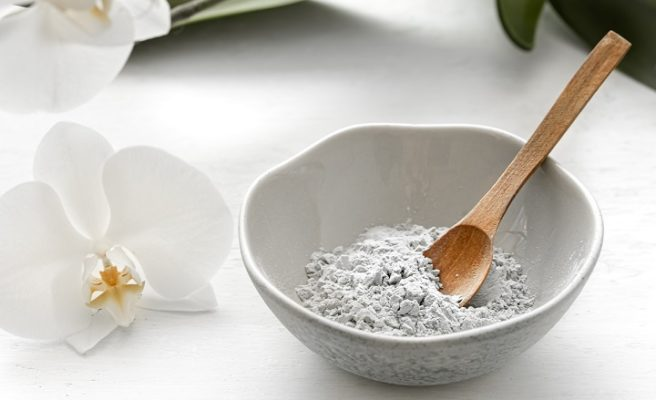 clay in a bowl with spoon