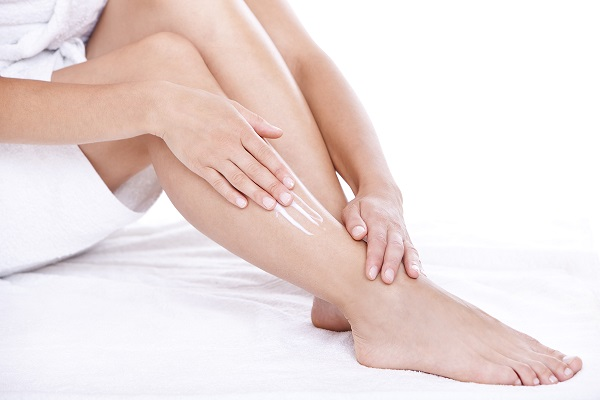 woman with lotion on legs