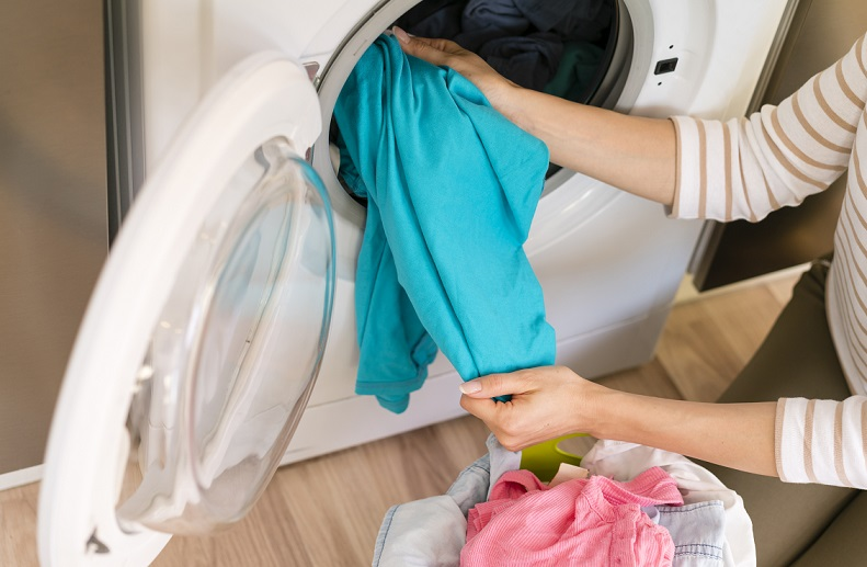 woman taking her laundry from the machine