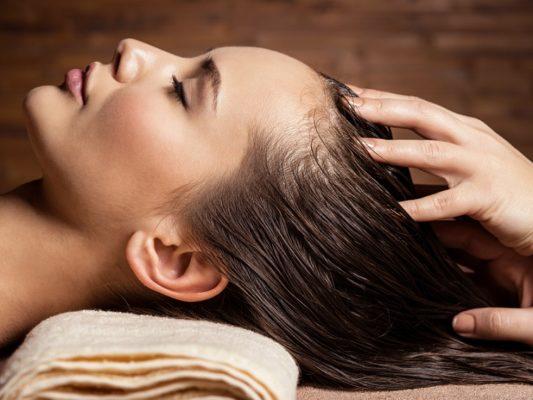 Masseur doing massage the head
